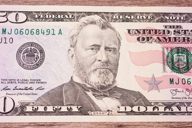 Background of the money, fifty dollar bills front side. background of dollars, close up, portrait of u.s. statesman, inventor, and diplomat ulysses s.