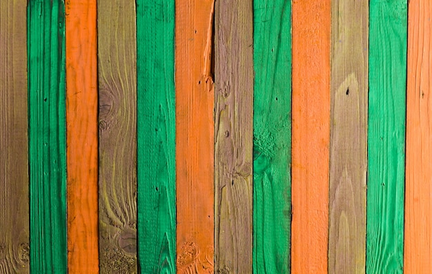 Background of multi-colored wooden boards. color fence. wooden texture.