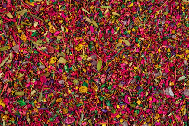 Background of multicolored dried flower petals blooms and herbs top view