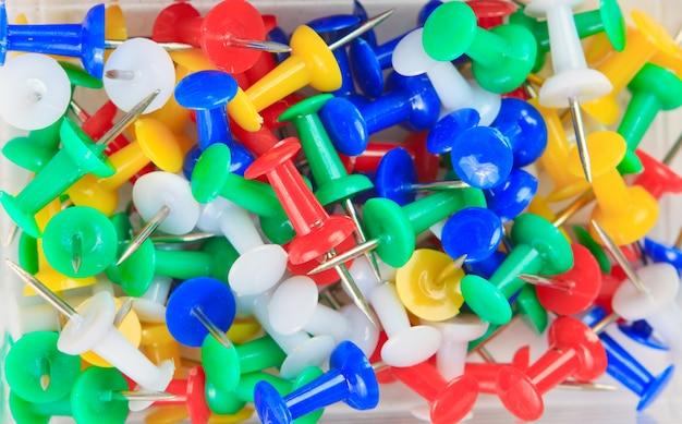Background of multicolored thumbtacks