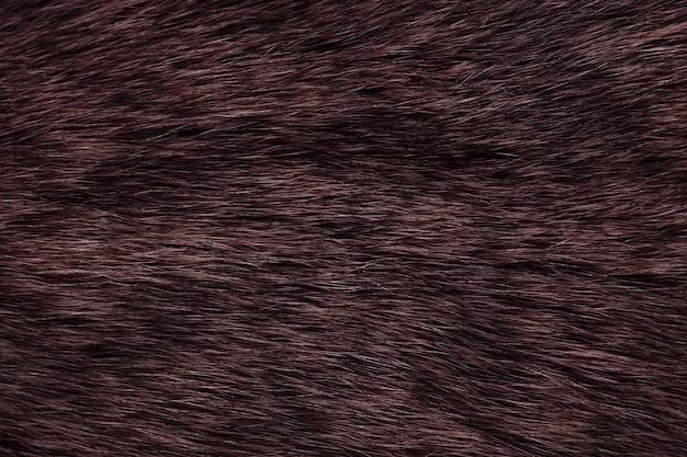 茶色の背景の自然な毛皮