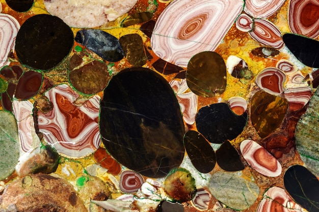 Background - a natural multi-colored stone, a conglomerate of jasper and agate