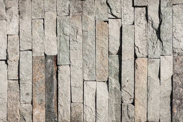 Background of natural stone tiles, marble brick wall