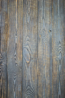 Background of natural wooden textured boards with traces of gray paint.