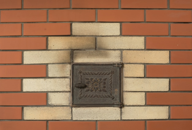 Background of new brown brick wall with furnace.