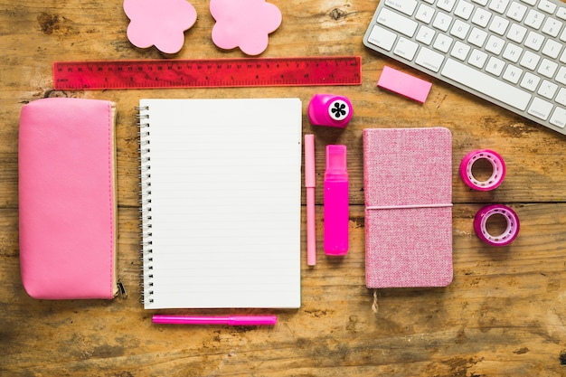 Background of notepad and colorful school supplies