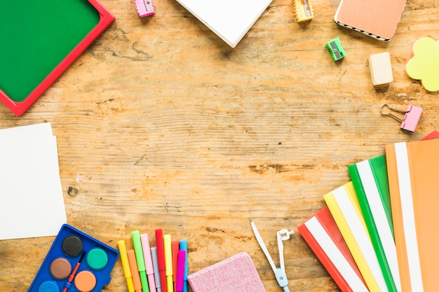 Background of notepads and colorful school supplies