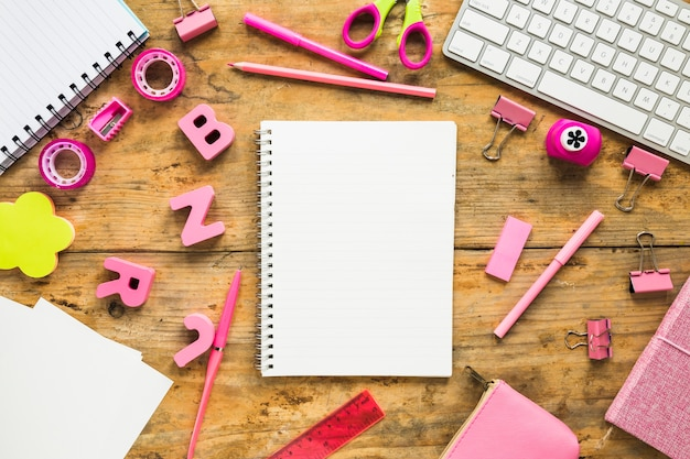 Background of notepads and pink school supplies