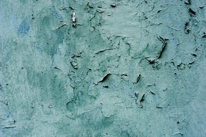青い漆喰の背景をコーティングし、塗装、セメントの荒いキャストとコンクリート壁のテクスチャを塗装