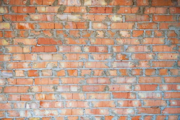 れんが造りのオレンジ色の壁の背景