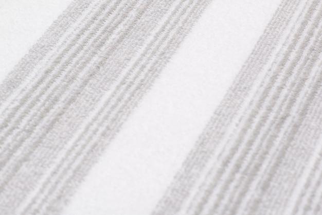 縞模様のバスタオルの背景。テクスチャード生地の背景