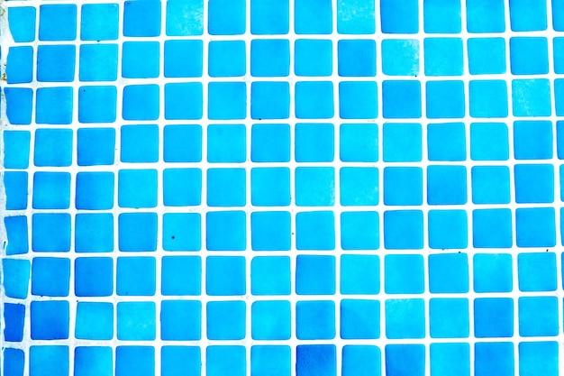 수영장에서 파란색 작은 타일의 배경
