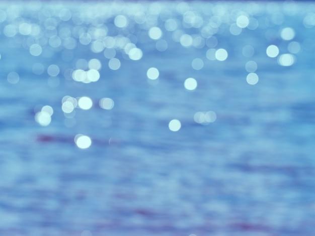Фон боке на поверхности воды.