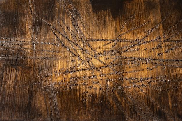 Фон коричневой старой доски с множеством царапин, горизонтальный вид