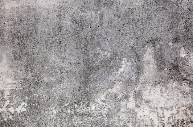 기름으로 시멘트 벽의 배경 금이 텍스처