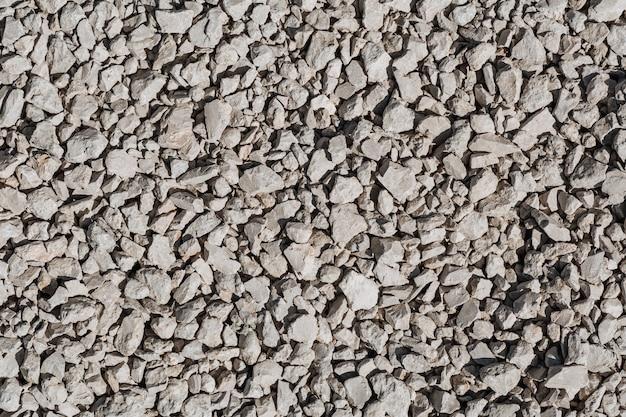 灰色の砕石の背景さまざまな形