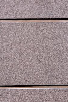 大理石のパン粉の壁装材の背景。