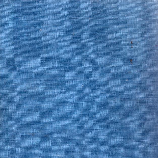 Фон старой синей книги в твердом переплете текстуры ткани