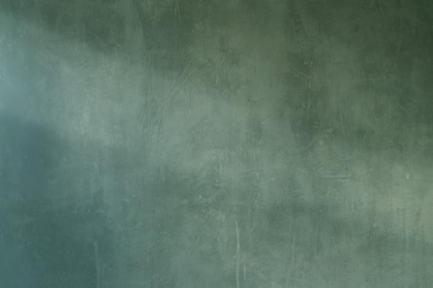 오래 된 녹색 시멘트 그런 지 벽의 배경