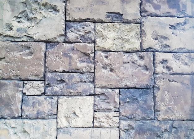 섬세 한 비네팅으로 오래 된 그런 지 벽돌 벽 텍스처의 배경.