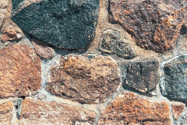 石と古い石壁の背景。