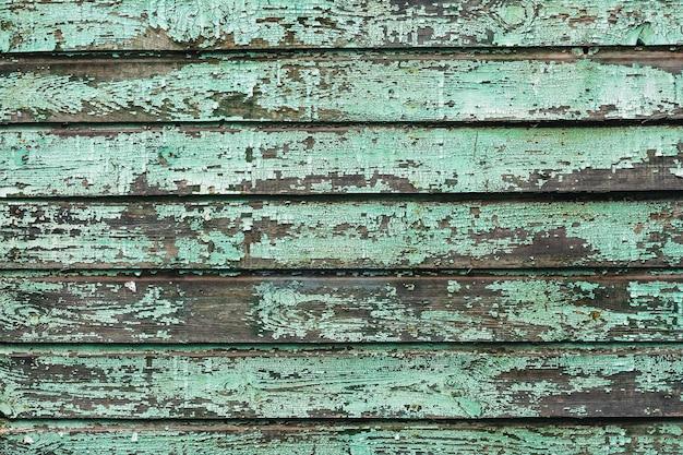 Фон из старых деревянных досок, окрашенных аквамариновой краской.