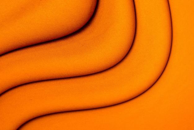 Фон из оранжевой ткани.