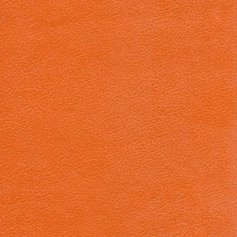 オレンジ色の革の質感の背景。