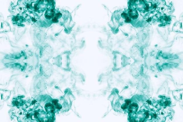 水中のペンキの背景。水中のペンキのパフ。染料の水への溶解。水質汚染。コンセプトアートの創造性。