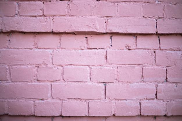 테두리가 있는 분홍색 벽돌 벽의 배경입니다.