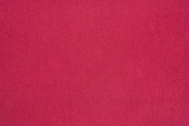 Предпосылка красной текстуры демикотона джинсовой ткани.