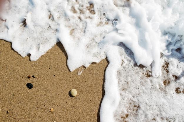 Фон из песка с волной.