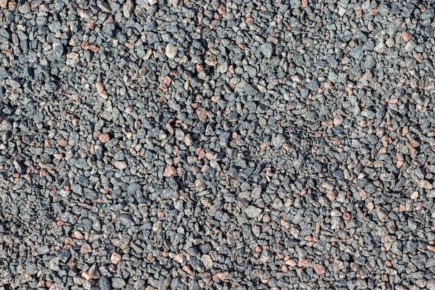 デザインのための小さな灰色の石の背景。砂利のテクスチャ