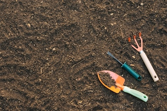 Background of soil with tools in garden