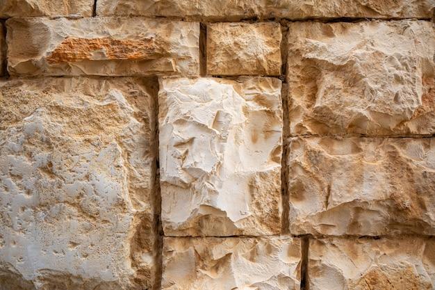 クロアチアのコルチュラ島、ヴェラ ルカの旧市街の建築の石壁のテクスチャの背景