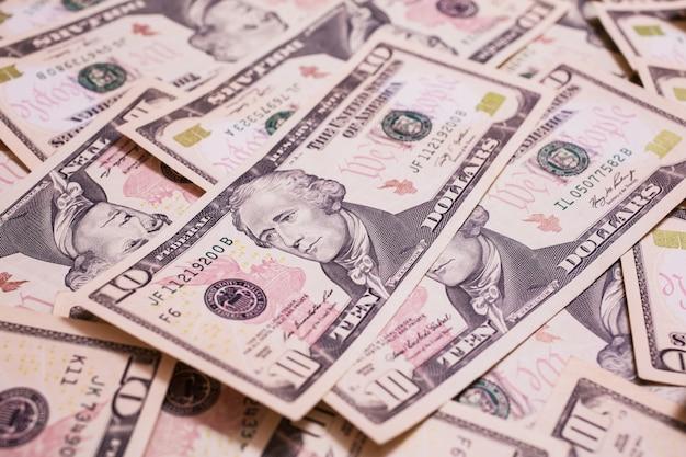 Предпосылка денег, лицевая сторона 10 долларовых банкнот. фон долларов, крупный план, сбережения