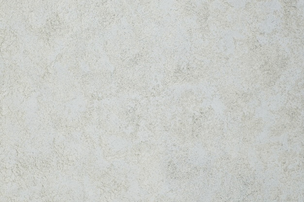 화강암 효과가 있는 치장 벽토 질감의 배경. 예술적 배경 수제