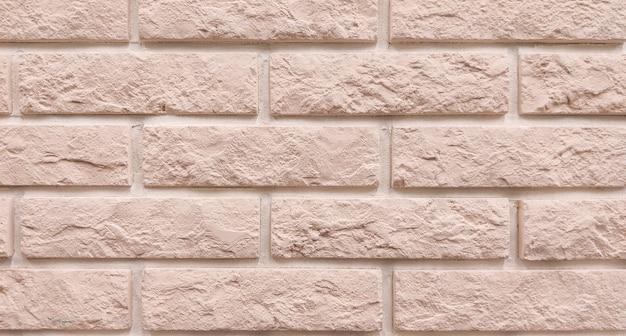 壁の背景は茶色のレンガの表面