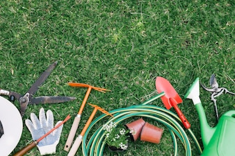 Background of tools on green grass in garden