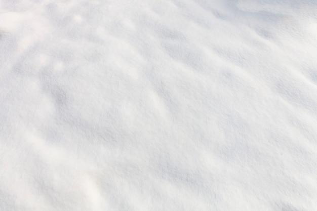 白い雪の背景。冬の風合い。高品質の写真