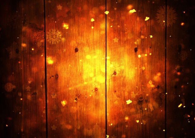 雪とキラキラボケ効果のある木の板の背景。