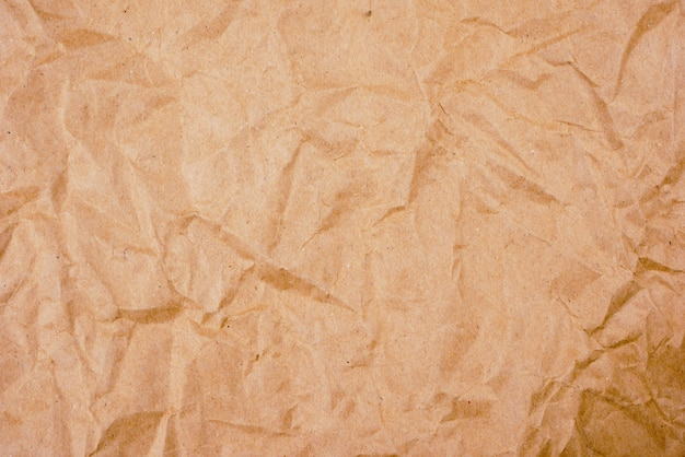 Background old brown crumpled paper texture