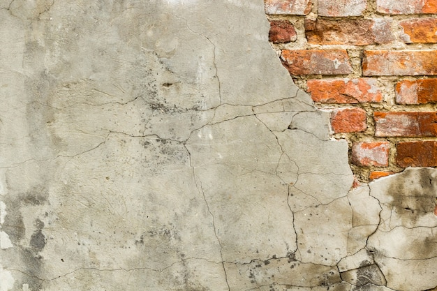 Background of old vintage brick wall with concrete
