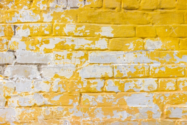 Background of old vintage dirty brick wall with peeling plaster.