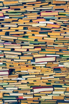 Background pattern of various books piles