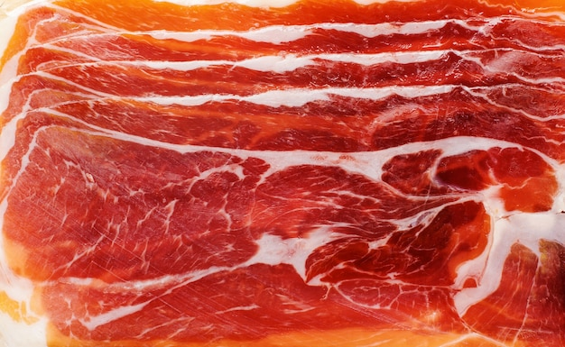 Background of pink meat jamon texture of smoked pork. top view.