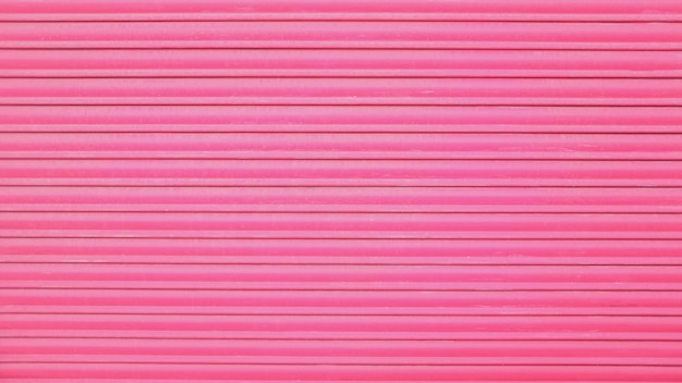Background of the pink metal door