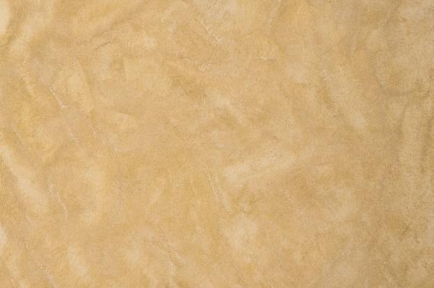 Background plastered texture sand color. artistic background handmade