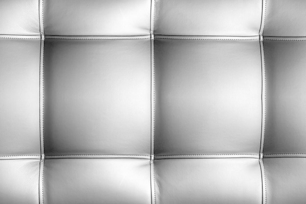 Background of quilted leather in silver color