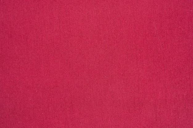 Background of red denim jean texture.
